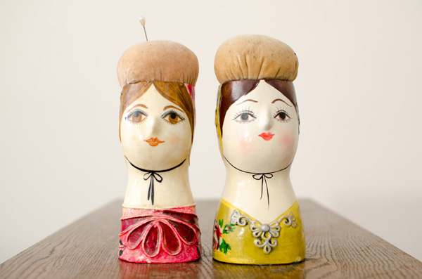 Two lady pincushion statues crafted from Papier-Mache by Gemma Taccogna.