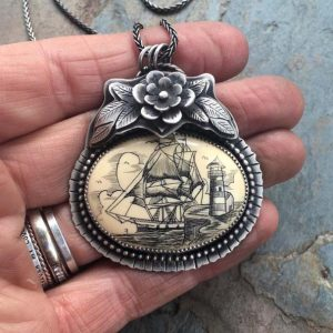 Scrimshaw Pendant with Flower Detail by Nicole of Arrok Metal Studio.