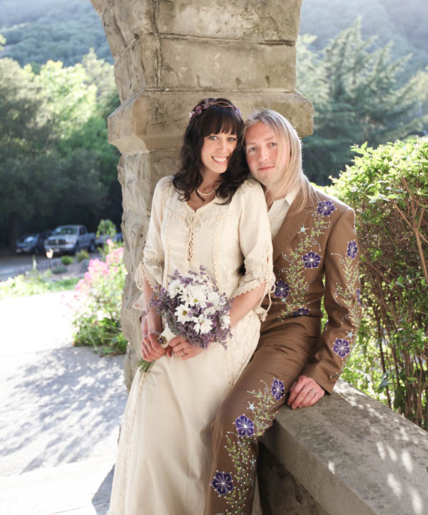 Me in my vintage black label Gunne Sax wedding dress and my husband in a custom embroidered suit by Jaime Castaneda.