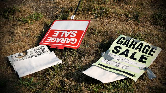 Garage sale signs on lawn.