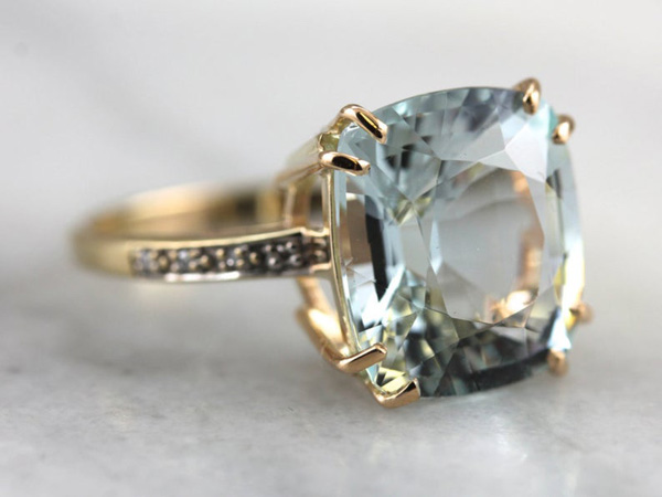 A yellow gold and aquamarine engagement ring by MSJewelers