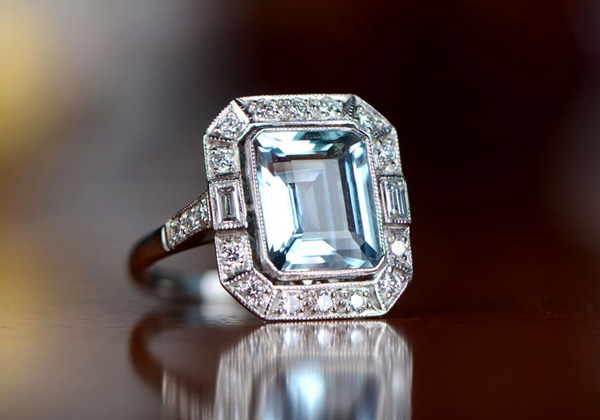 An Art Deco platinum, aquamarine, and diamond ring offered by EstateDiamondJewelry