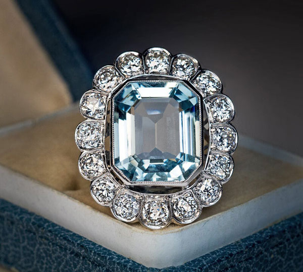 A vintage aquamarine and diamond halo ring offered by RomanovRussiacom